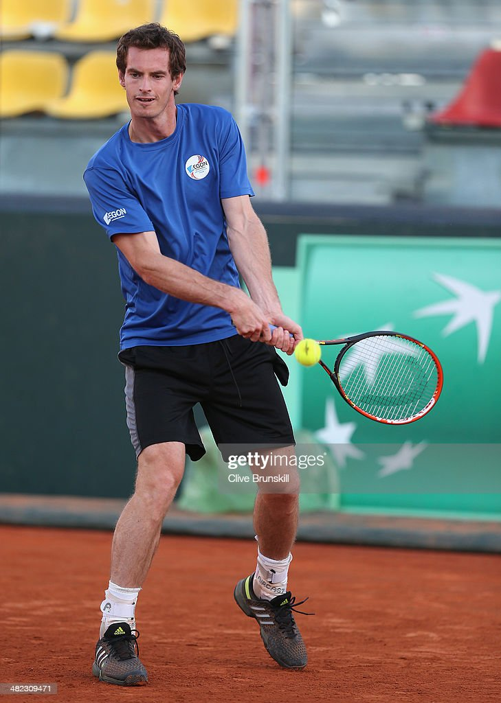 Andy Murray of Great Britain plays a backhand during a late practice session prior to the Davis Cup World Group Quarter Final match between Italy and Great Britain at Tennis Club Napoli on April 3, 2014 in Naples, Italy.