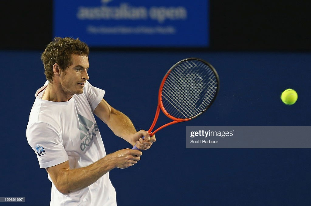 Andy Murray of Great Britain plays a backhand during a practice session ahead of the 2013 Australian Open at Melbourne Park on January 13, 2013 in Melbourne, Australia.
