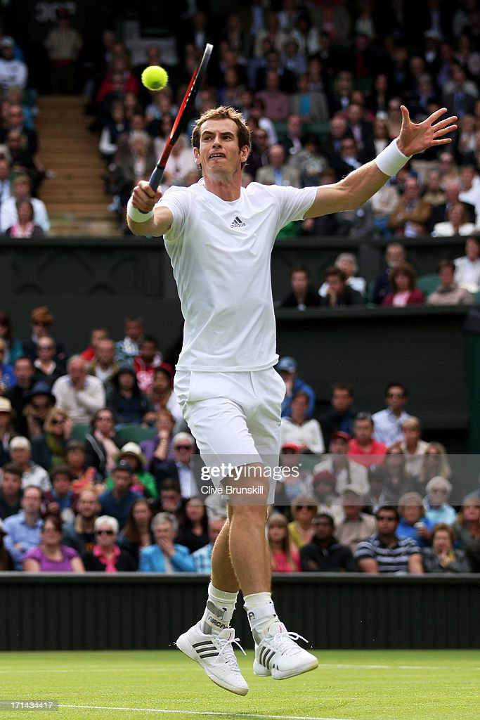 Andy Murray of Great Britain plays a backhand during his Gentlemen's Singles first round match against Benjamin Becker of Germany on day one of the Wimbledon Lawn Tennis Championships at the All England Lawn Tennis and Croquet Club on June 24, 2013 in London, England.