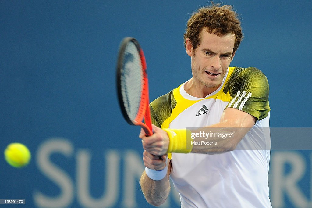 Andy Murray of Great Britain plays a backhand during his semi final match against Kei Nishikori of Japan on day seven of the Brisbane International at Pat Rafter Arena on January 5, 2013 in Brisbane, Australia.