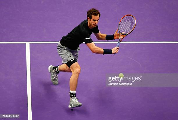 Andy Murray of Great Britain plays a backhand during his Tie Break Tens singles match against David Ferrer of Spain during day four of the Masters...