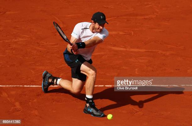 Andy Murray of Great Britain plays a backhand during mens singles quarter finals match against Kei Nishikori of Japan on day eleven of the 2017...