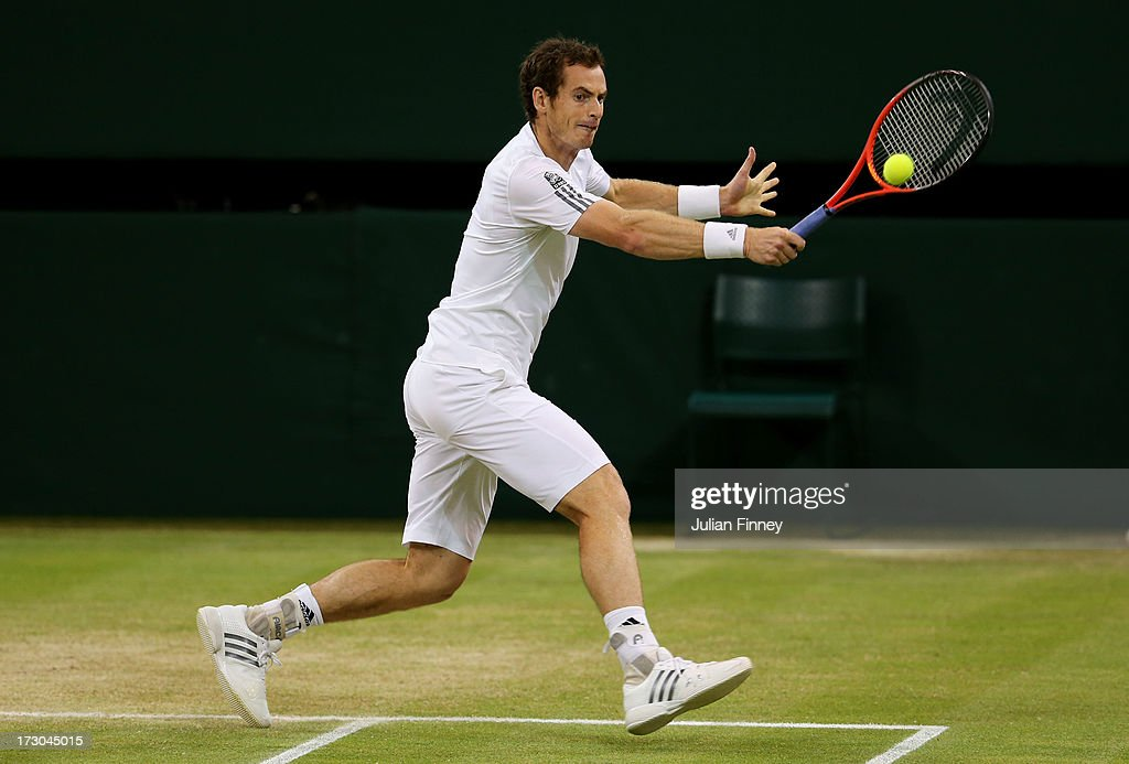 Andy Murray of Great Britain plays a backhand during the Gentlemen's Singles semi-final match against Jerzy Janowicz of Poland on day eleven of the Wimbledon Lawn Tennis Championships at the All England Lawn Tennis and Croquet Club on July 5, 2013 in London, England.