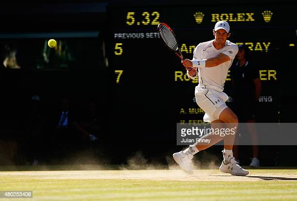 Andy Murray of Great Britain plays a backhand during the Gentlemens Singles Semi Final match against Roger Federer of Switzerland during day eleven...