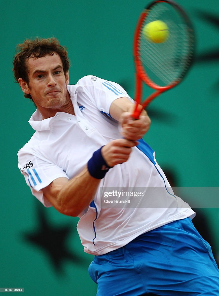 Andy Murray of Great Britain plays a backhand during the men's singles second round match between Andy Murray of Great Britain and Juan Ignacio Chela of Argentina on day five of the French Open at Roland Garros on May 27, 2010 in Paris, France.