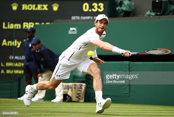 Andy Murray of Great Britain plays a backhand during the Men's Singles first round match against Liam Broady of Great Britain on day two of the...