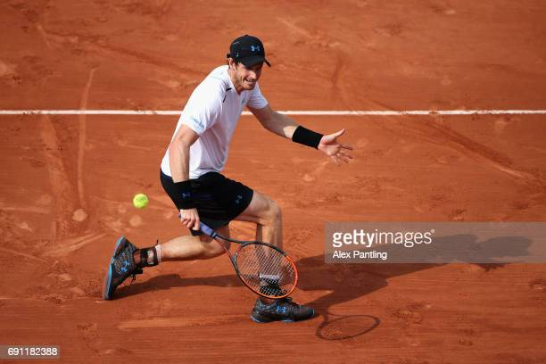 Andy Murray of Great Britain plays a backhand during the mens singles second round match against Martin Klizan of Slovakia on day five of the 2017...