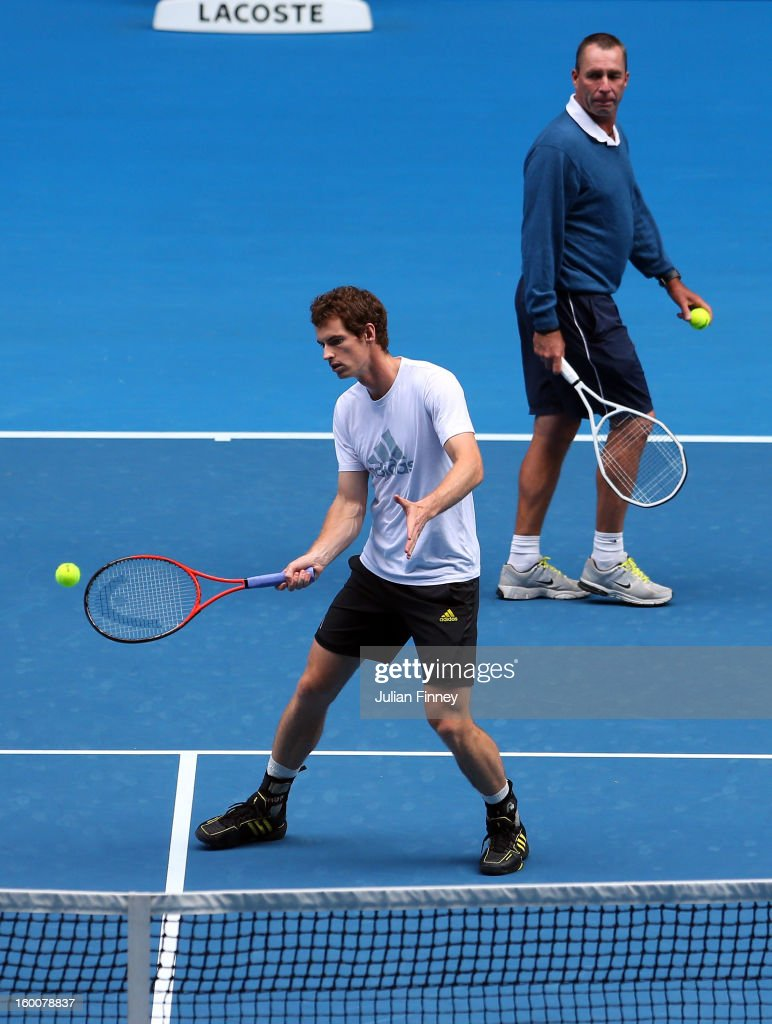 Andy Murray of Great Britain plays a backhand in a practice session as his coach, Ivan Lendl looks on during day thirteen of the 2013 Australian Open at Melbourne Park on January 26, 2013 in Melbourne, Australia.
