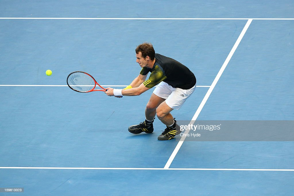 Andy Murray of Great Britain plays a backhand in his fourth round match against Gilles Simon of France during day eight of the 2013 Australian Open at Melbourne Park on January 21, 2013 in Melbourne, Australia.