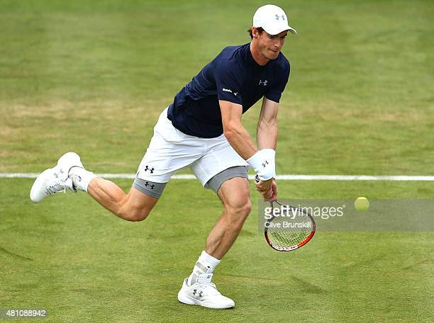 Andy Murray of Great Britain plays a backhand in his match against JoWilfried Tsonga of France during Day One of the World Group Quarter Final Davis...