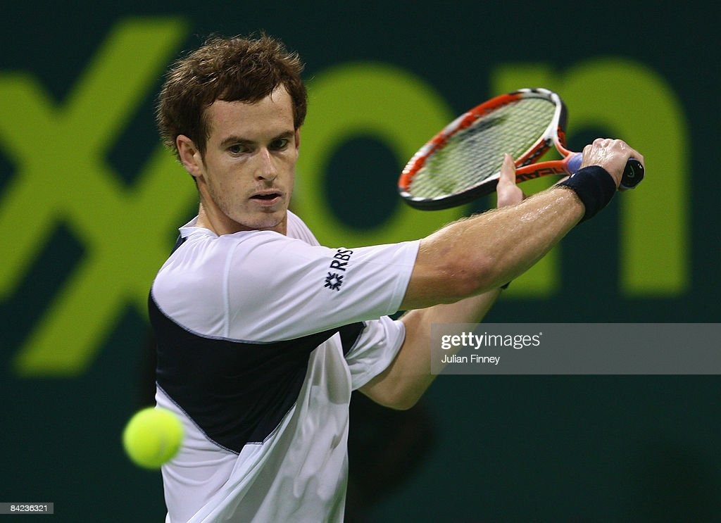 Andy Murray of Great Britain plays a backhand in his match against Andy Roddick of United States during the final of the Exxon Mobil Qatar Open...