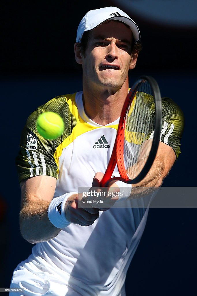 Andy Murray of Great Britain plays a backhand in his third round match against Ricardas Berankis of Lithuania during day six of the 2013 Australian Open at Melbourne Park on January 19, 2013 in Melbourne, Australia.