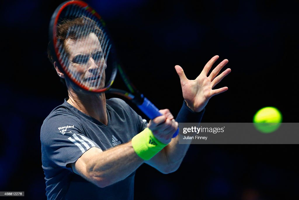 Andy Murray of Great Britain plays a backhand in the round robin singles match against Milos Raonic of Canada on day three of the Barclays ATP World Tour Finals at the O2 Arena on November 11, 2014 in London, England
