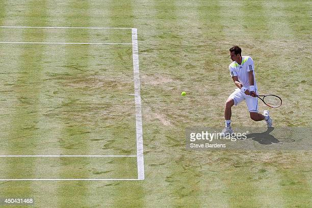 Andy Murray of Great Britain plays a backhand shot against PaulHenri Mathieu of France during their Men's Singles match on day three of the Aegon...