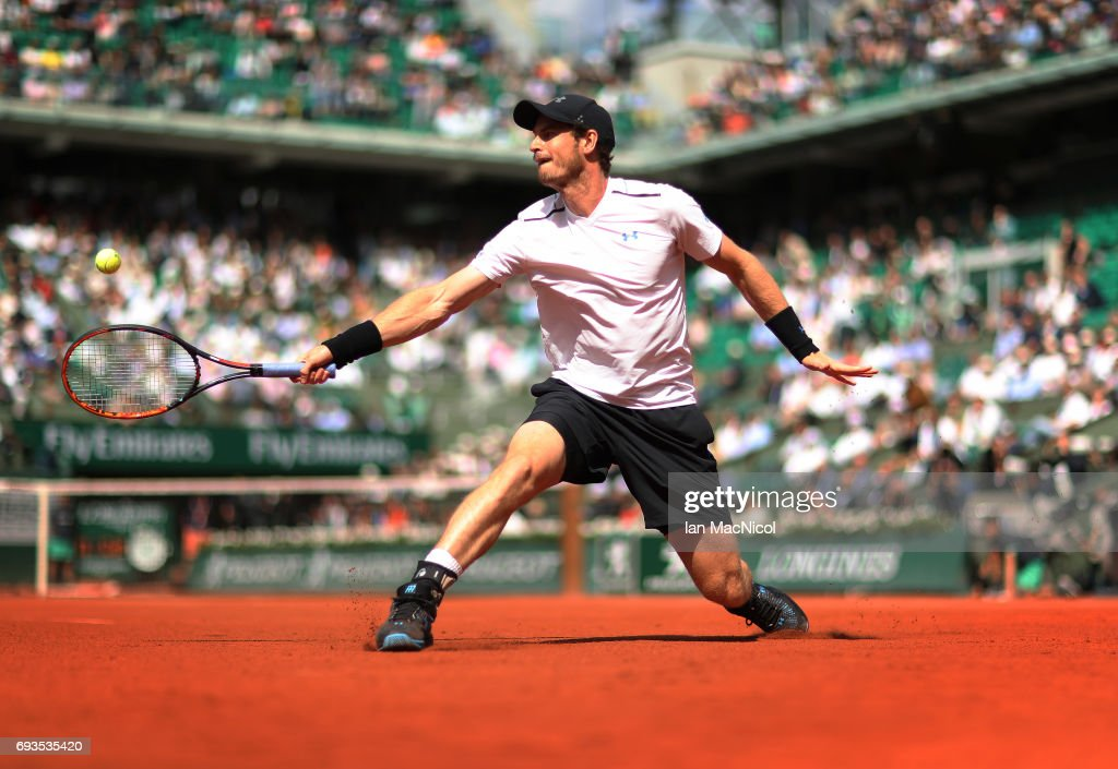 Andy Murray of Great Britain plays a backhand shot during his match with Kei Nishikori of Japan, on day eleven at Roland Garros on June 7, 2017 in Paris, France.