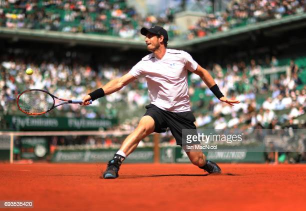 Andy Murray of Great Britain plays a backhand shot during his match with Kei Nishikori of Japan on day eleven at Roland Garros on June 7 2017 in...
