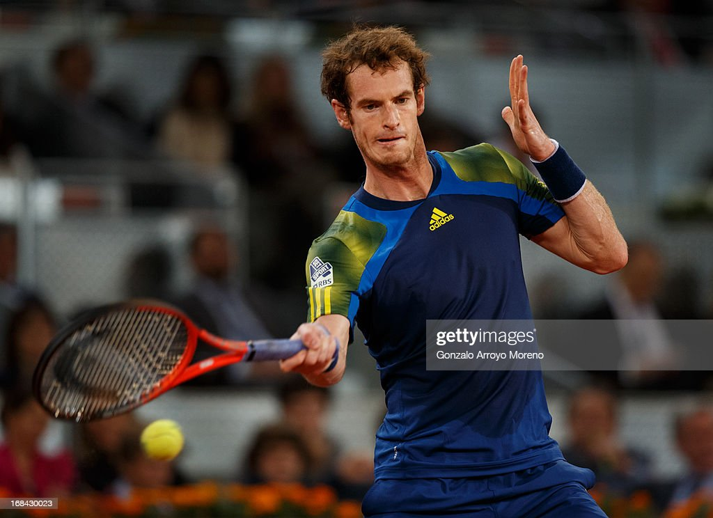 <a gi-track='captionPersonalityLinkClicked' href=/galleries/search?phrase=Andy+Murray+-+Tennis+Player&family=editorial&specificpeople=200668 ng-click='$event.stopPropagation()'>Andy Murray</a> of Great Britain plays a backhand to Gilles Simon of France during his match on day six of the Mutua Madrid Open tennis tournament at the Caja Magica on May 9, 2013 in Madrid, Spain.