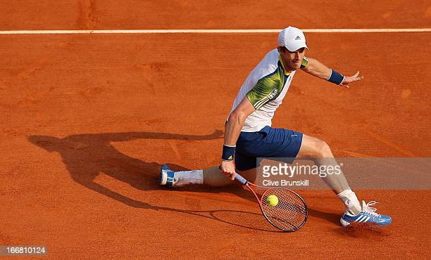 Andy Murray of Great Britain plays a backhand volley against Edouard RogerVasselin of France in their second round match during day four of the ATP...