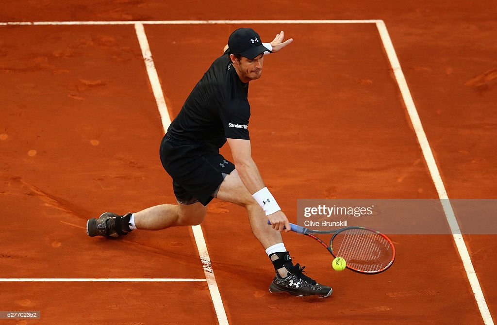 <a gi-track='captionPersonalityLinkClicked' href=/galleries/search?phrase=Andy+Murray+-+Tennis+Player&family=editorial&specificpeople=200668 ng-click='$event.stopPropagation()'>Andy Murray</a> of Great Britain plays a backhand volley against Radek Stepanek of the Czech Republic in their second round match during day four of the Mutua Madrid Open tennis tournament at the Caja Magica on May 03, 2016 in Madrid,Spain.