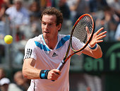 Andy Murray of Great Britain plays a backhand volley during his straight sets defeat in the fourth rubber by Fabio Fognini of Italy during day three...