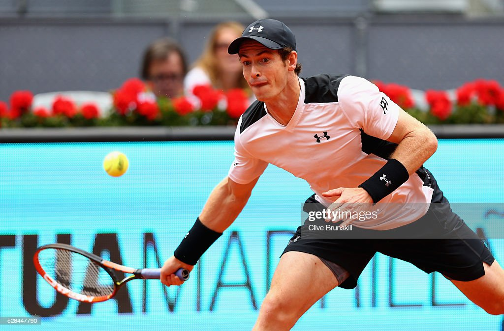 Andy Murray of Great Britain plays a forehand against Gilles Simon of France in their third round match during day six of the Mutua Madrid Open tennis tournament at the Caja Magica on May 05, 2016 in Madrid,Spain