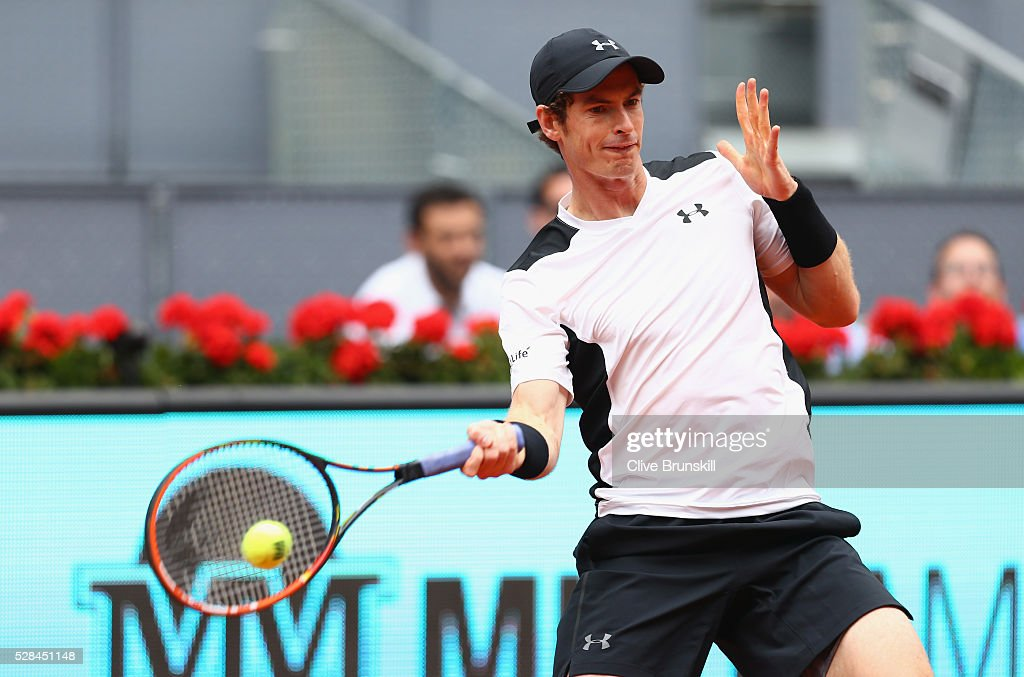 <a gi-track='captionPersonalityLinkClicked' href=/galleries/search?phrase=Andy+Murray+-+Tennis+Player&family=editorial&specificpeople=200668 ng-click='$event.stopPropagation()'>Andy Murray</a> of Great Britain plays a forehand against Gilles Simon of France in their third round match during day six of the Mutua Madrid Open tennis tournament at the Caja Magica on May 05, 2016 in Madrid,Spain