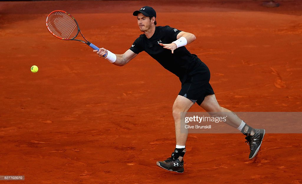 <a gi-track='captionPersonalityLinkClicked' href=/galleries/search?phrase=Andy+Murray+-+Tennis+Player&family=editorial&specificpeople=200668 ng-click='$event.stopPropagation()'>Andy Murray</a> of Great Britain plays a forehand against Radek Stepanek of the Czech Republic in their second round match during day four of the Mutua Madrid Open tennis tournament at the Caja Magica on May 03, 2016 in Madrid,Spain.