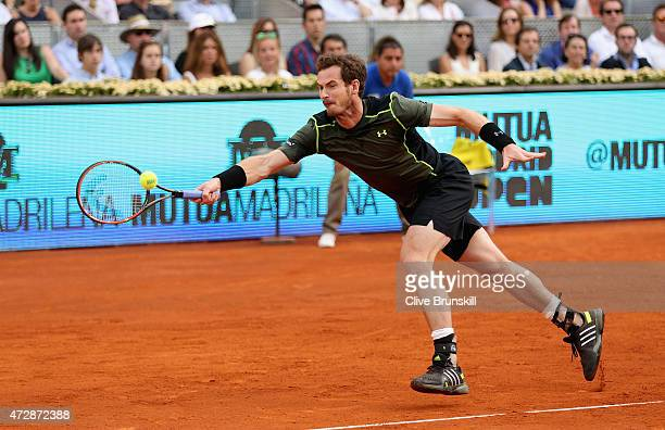 Andy Murray of Great Britain plays a forehand against Rafael Nadal of Spain in the mens final during day nine of the Mutua Madrid Open tennis...