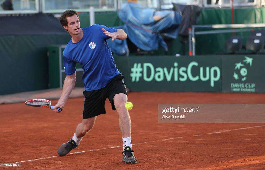 Andy Murray of Great Britain plays a forehand during a late practice session prior to the Davis Cup World Group Quarter Final match between Italy and Great Britain at Tennis Club Napoli on April 3, 2014 in Naples, Italy.