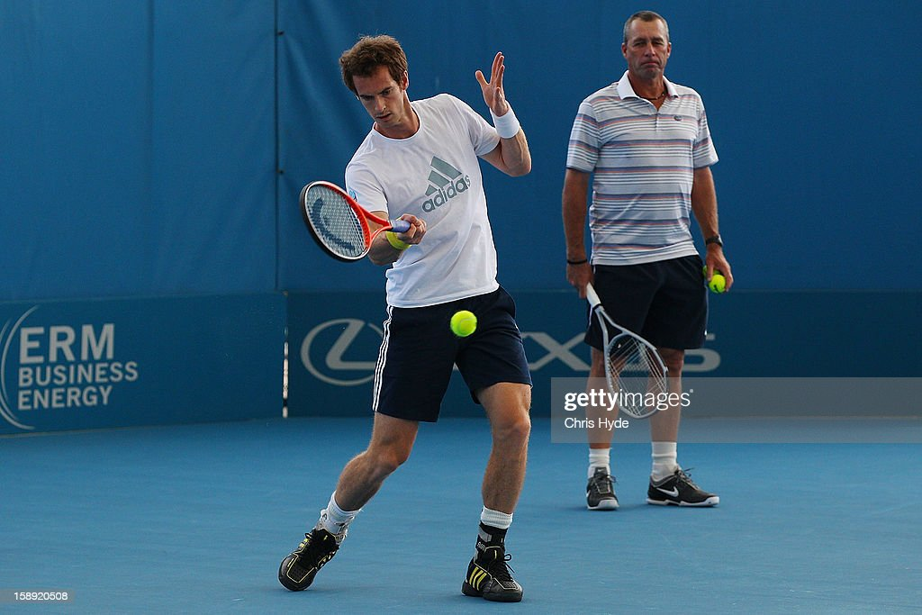 Andy Murray of Great Britain plays a forehand during a practice session while his coach Ivan Lendl watches on during day six of the Brisbane International at Pat Rafter Arena on January 4, 2013 in Brisbane, Australia.