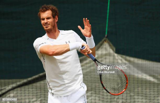 Andy Murray of Great Britain plays a forehand during practice ahead of Wimbledon Lawn Tennis Championships at the All England Lawn Tennis and Croquet...
