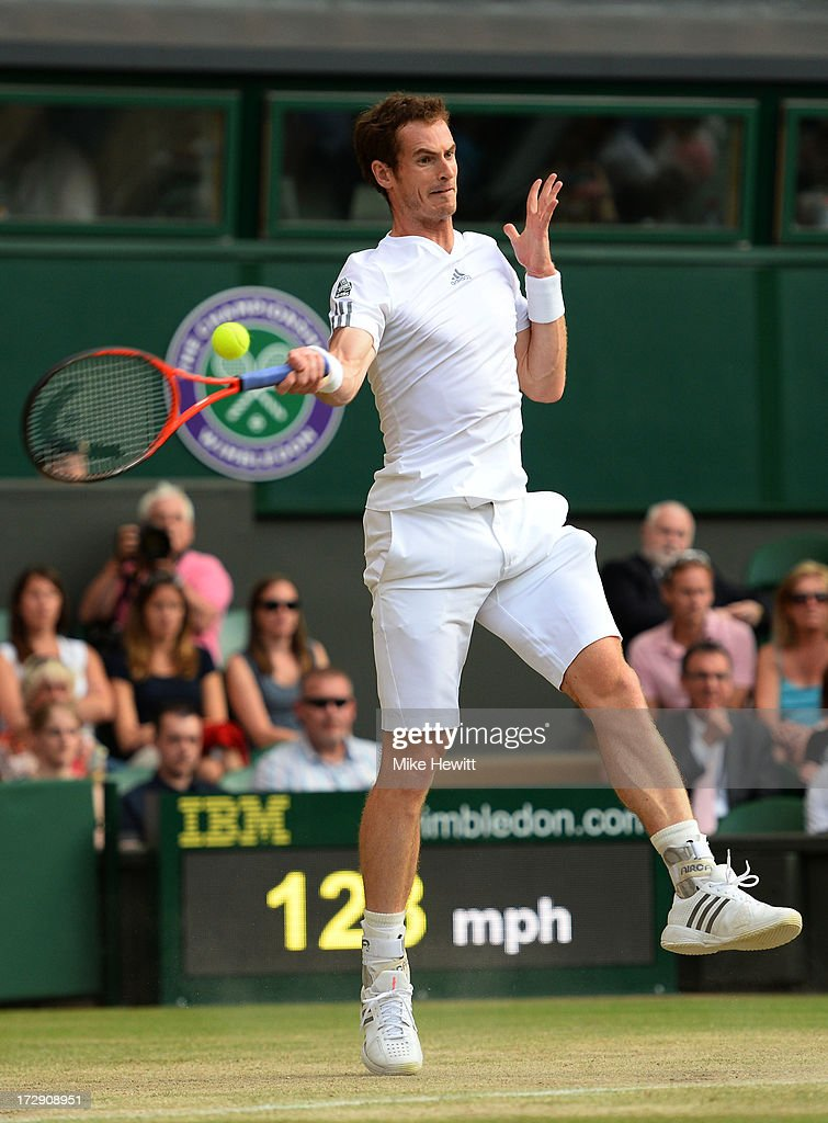 Andy Murray of Great Britain plays a forehand during the Gentlemen's Singles semi-final match against Jerzy Janowicz of Poland on day eleven of the Wimbledon Lawn Tennis Championships at the All England Lawn Tennis and Croquet Club on July 5, 2013 in London, England.