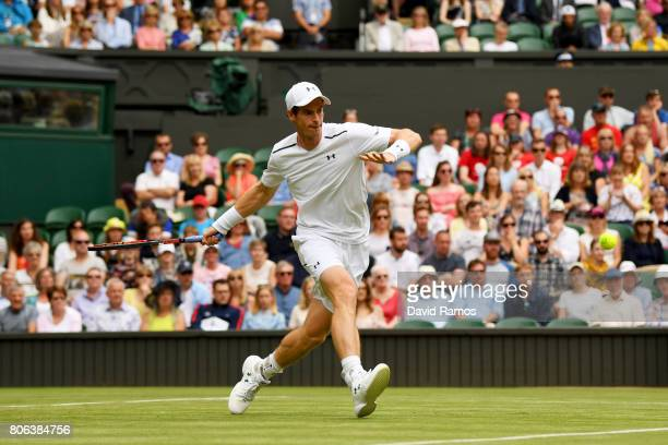 Andy Murray of Great Britain plays a forehand during the Gentlemen's Singles first round match on day one of the Wimbledon Lawn Tennis Championships...
