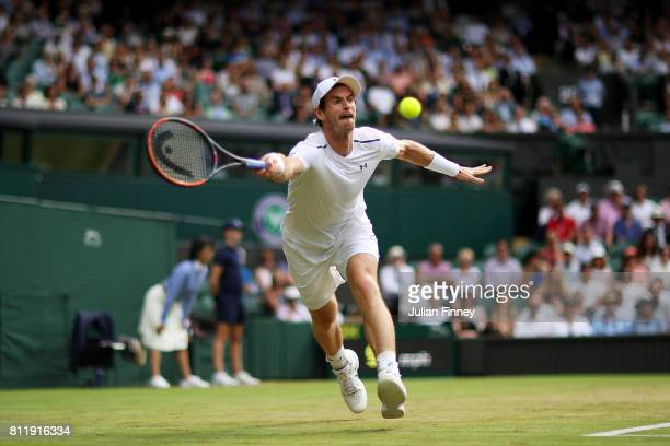 Andy Murray of Great Britain plays a forehand during the Gentlemen's Singles fourth round match against Benoit Paire of France on day seven of the...