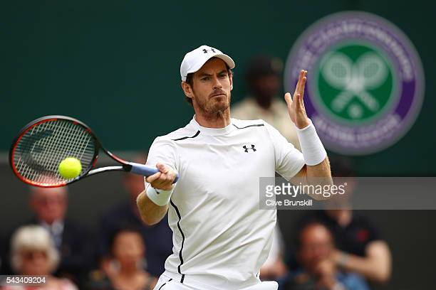 Andy Murray of Great Britain plays a forehand during the Men's Singles first round match against Liam Broady of Great Britain on day two of the...