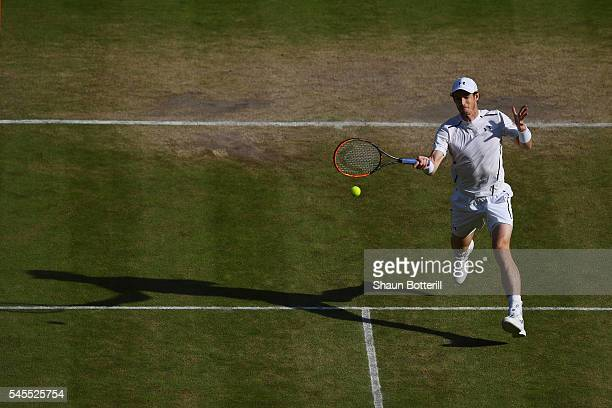 Andy Murray of Great Britain plays a forehand during the Men's Singles Semi Final match against Tomas Berdych of The Czech Republic on day eleven of...