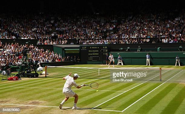 Andy Murray of Great Britain plays a forehand during the Men's Singles Final against Milos Raonic of Canada on day thirteen of the Wimbledon Lawn...
