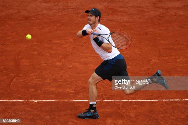 Andy Murray of Great Britain plays a forehand during the men's singles fourth round match against Karen Khachanov of Russia on day nine of the 2017...