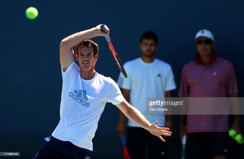 Andy Murray of Great Britain plays a forehand in front of his coaches Dani Vallverdu and Ivan Lendl during a practice session ahead of the 2013 US...