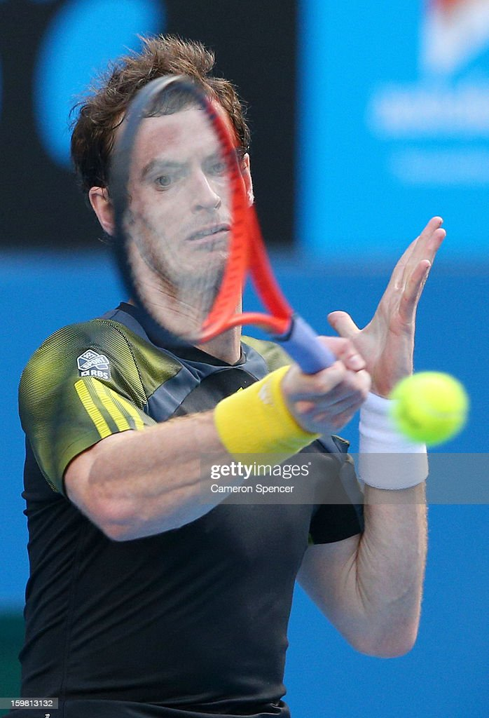 Andy Murray of Great Britain plays a forehand in his fourth round match against Gilles Simon of France during day eight of the 2013 Australian Open at Melbourne Park on January 21, 2013 in Melbourne, Australia.