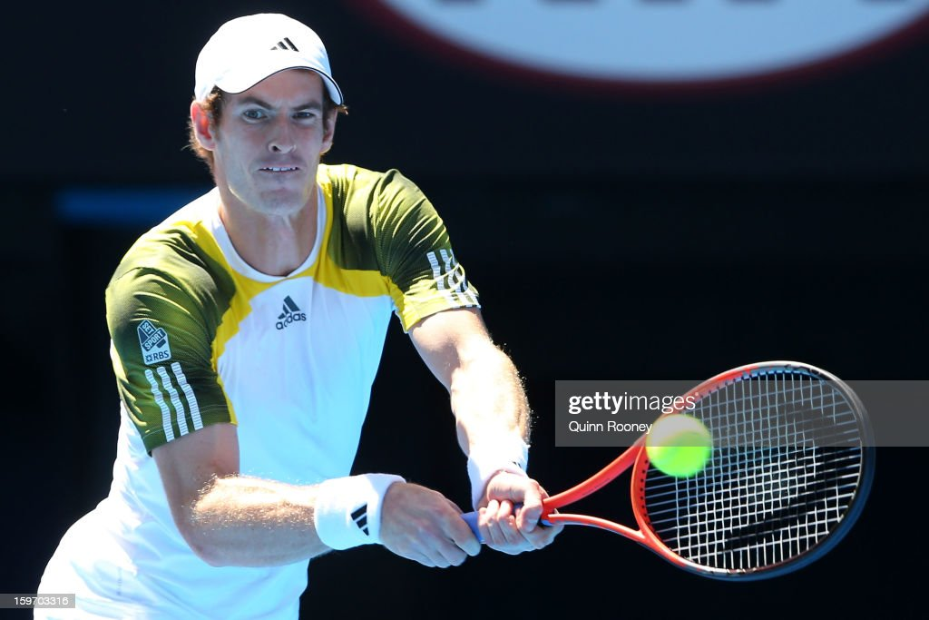 Andy Murray of Great Britain plays a forehand in hisr third round match against Ricardas Berankis of Lithuania during day six of the 2013 Australian Open at Melbourne Park on January 19, 2013 in Melbourne, Australia.