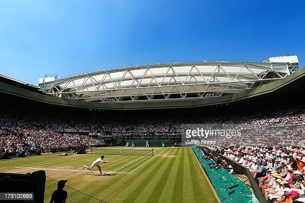 Andy Murray of Great Britain plays a forehand on Centre Court during the Gentlemen's Singles Final match against Novak Djokovic of Serbia on day...
