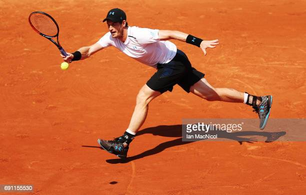 Andy Murray of Great Britain plays a forehand shot during his match with Martin Klizan of Slovakia on Day Five at Roland Garros on June 1 2017 in...