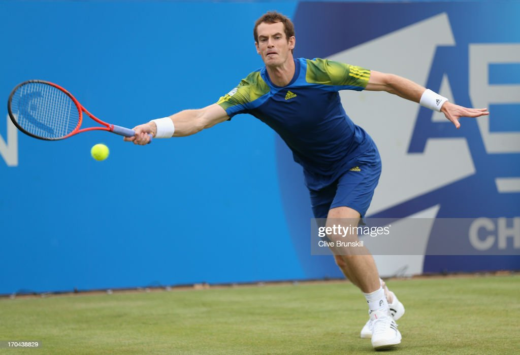 Andy Murray of Great Britain plays a forehand shot during the Men's Singles second round match against Nicolas Mahut of France on day four of the AEGON Championships at Queens Club on June 13, 2013 in London, England.