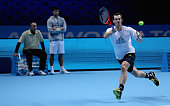 Andy Murray of Great Britain plays a forehand watched by his coach Ivan Lendl and hitting partner Daniel Vallverdu during a practice session prior to...