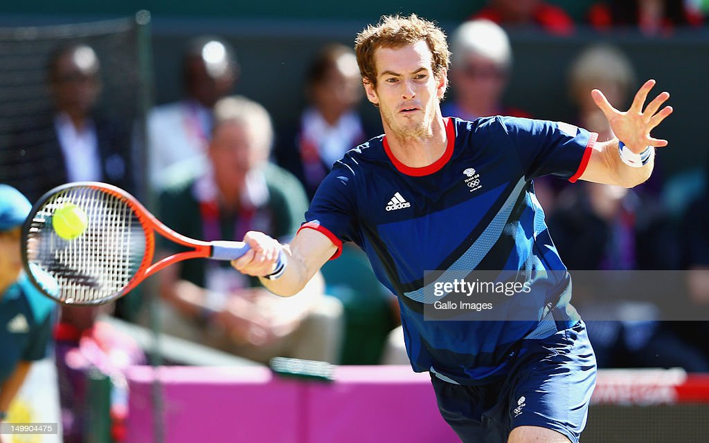 Andy Murray of Great Britain plays a shot against Roger Federer of Switzerland during the Men's Singles Tennis Gold Medal Match on Day 9 of the London 2012 Olympic Games, at the All England Lawn Tennis and Croquet Club on August 5, 2012 in London, England.