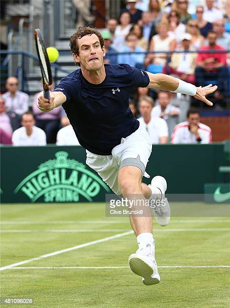 Andy Murray of Great Britain plays a volley in his match against JoWilfried Tsonga of France during Day One of the World Group Quarter Final Davis...