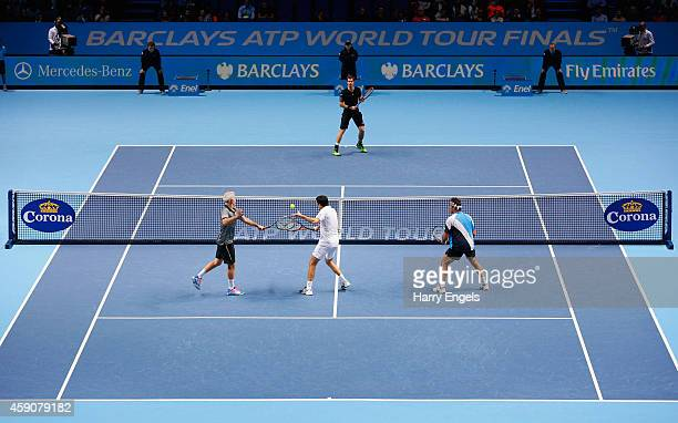 Andy Murray of Great Britain plays against John McEnroe Rim Henman and Pat Cash in the exhibition match on day eight of the Barclays ATP World Tour...