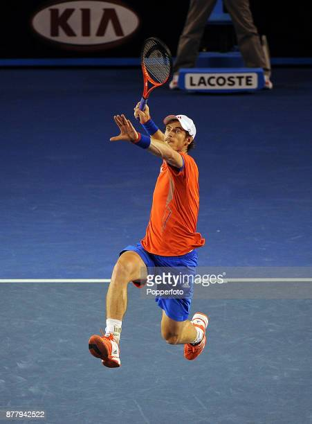 Andy Murray of Great Britain plays an acrobatic overhead smash during his men's singles semi final against Novak Djokovic of Serbia on day twelve of...