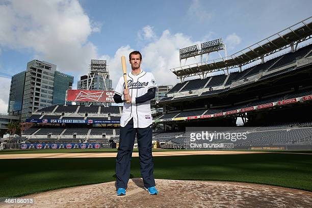 Andy Murray of Great Britain poses for a photograph in a San Diego Padres baseball kit after his straight sets victory against Donald Young of the...